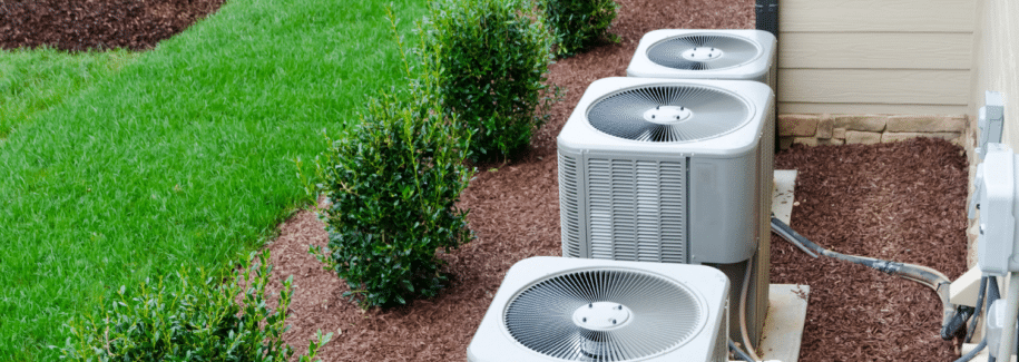 3 outdoor condensers in landscape